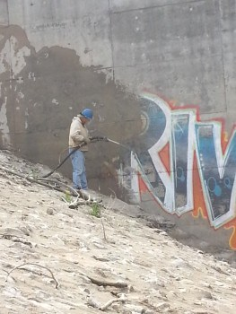Graffiti removal using a dustless blasting process